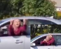 VIDEO: Woman Driver Crashes Car While Flipping the Bird at Trump Supporters